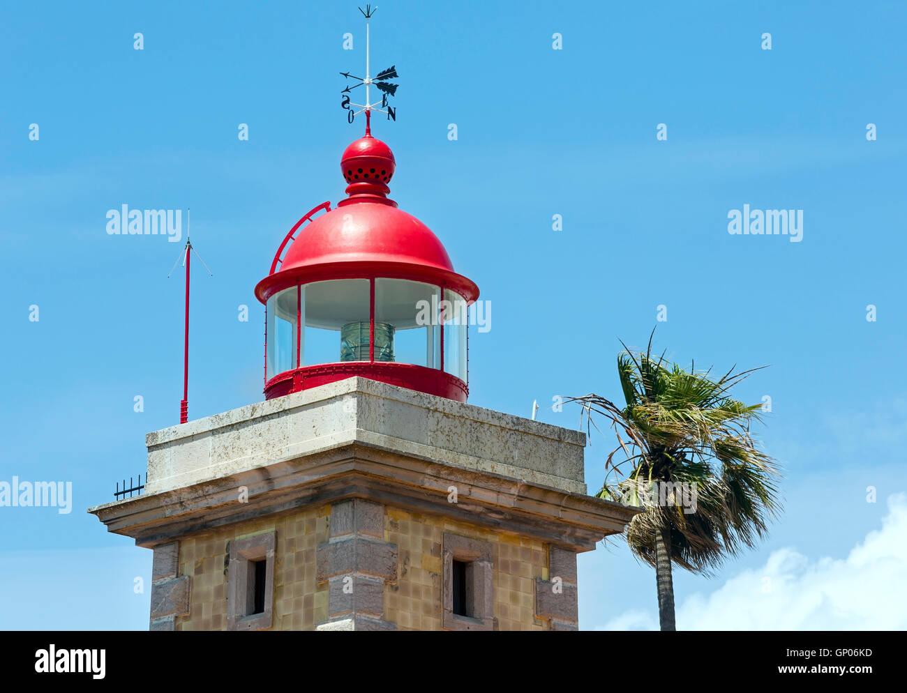 Lighthouse top on sky background (Ponta da Piedade cape, Lagos, Algarve, Portugal). Stock Photo