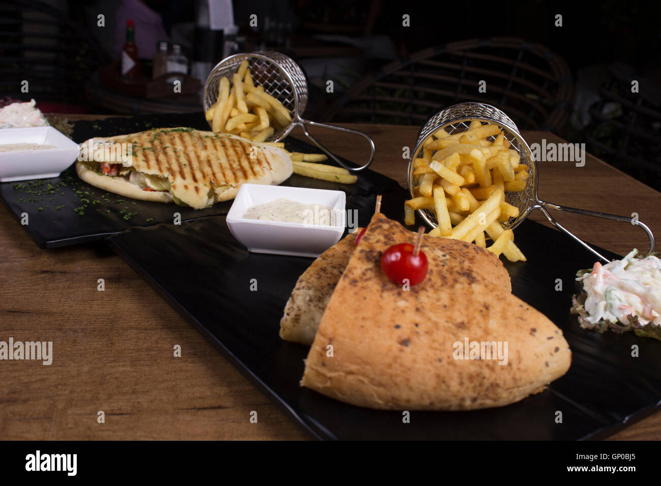 Cajun spiced cottage cheese sandwich and Greek pita gyro - Stock Image