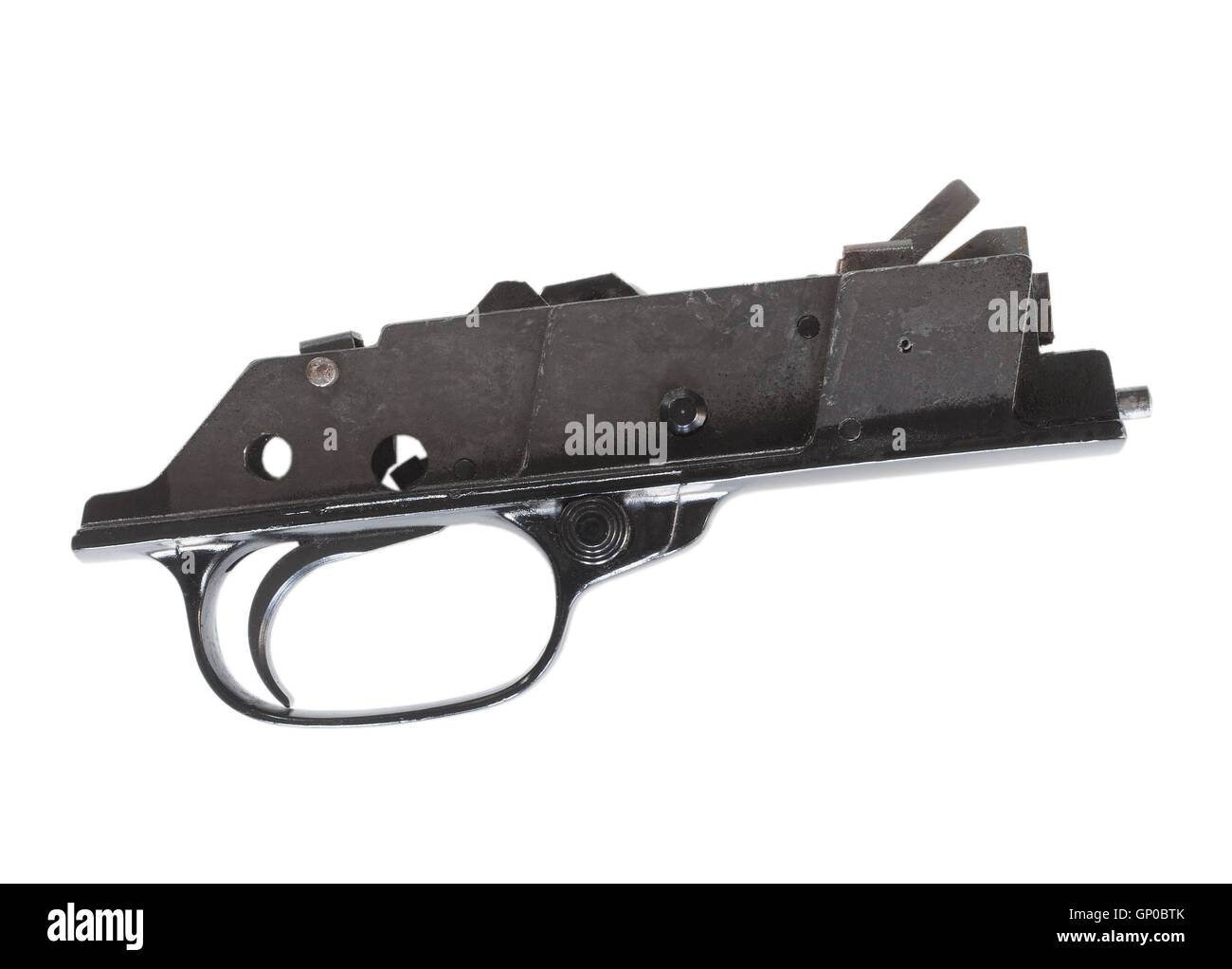 Trigger group and mechanism from a rifle seen from the side on white - Stock Image