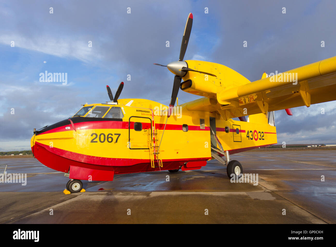 Water bomber Bombardier CL-415 Superscooper on the tarmac of it's homebase in Torrejon, Spain. - Stock Image