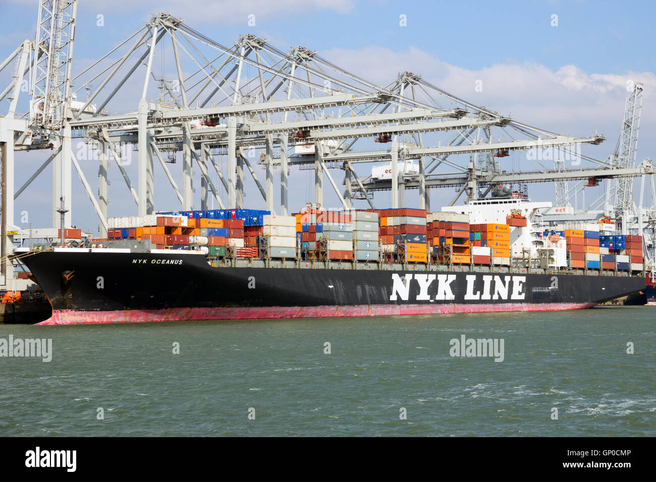 Container ship Nyk Oceanus from NYK Line moored at a container terminal in the Port of Ro - Stock Image
