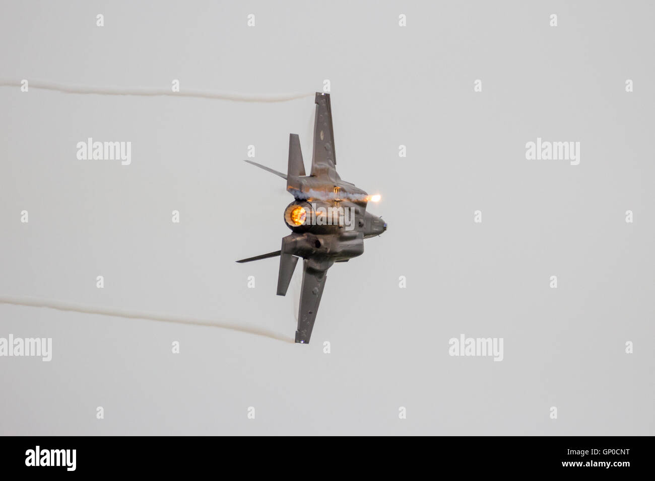 F-35 Lightning II firing off flares during a flyby on it's European debut in Leeuwarden, The Netherlands - Stock Image