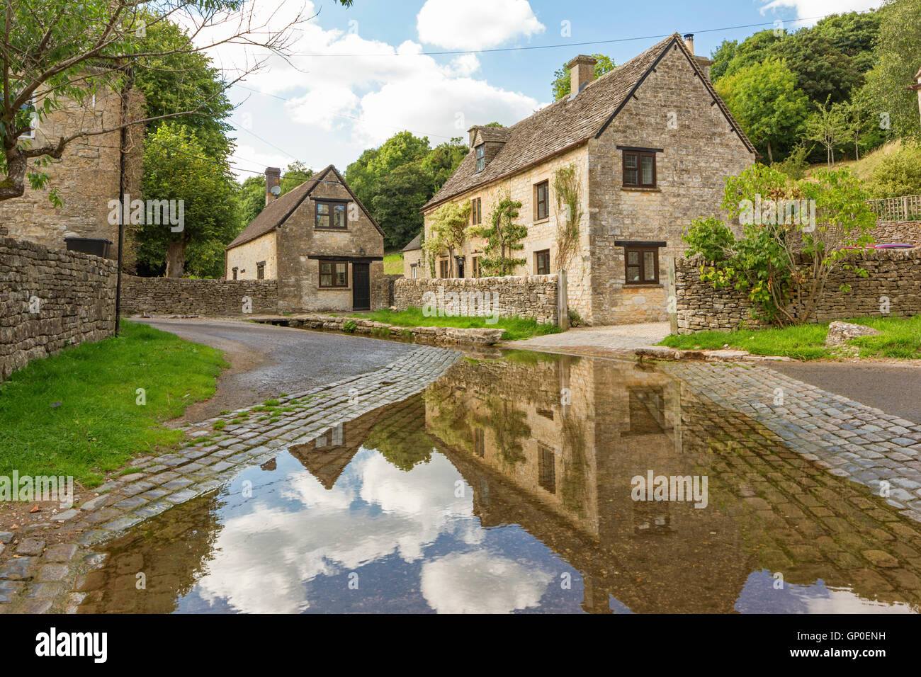 The River Dunt passes through the village of Duntisbourne Leer where this attractive ford can found, Gloucestershire, - Stock Image