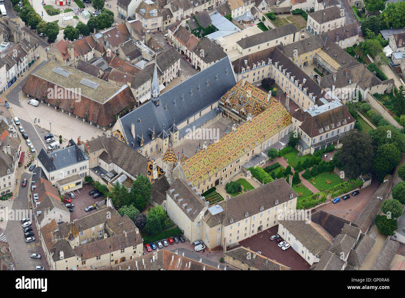 MEDIEVAL HOSPICE OF BEAUNE WITH ITS ROOF OF GLAZED TILES (aerial view). Hotel-Dieu of Beaune, Cote d'Or, Burgundy, - Stock Image