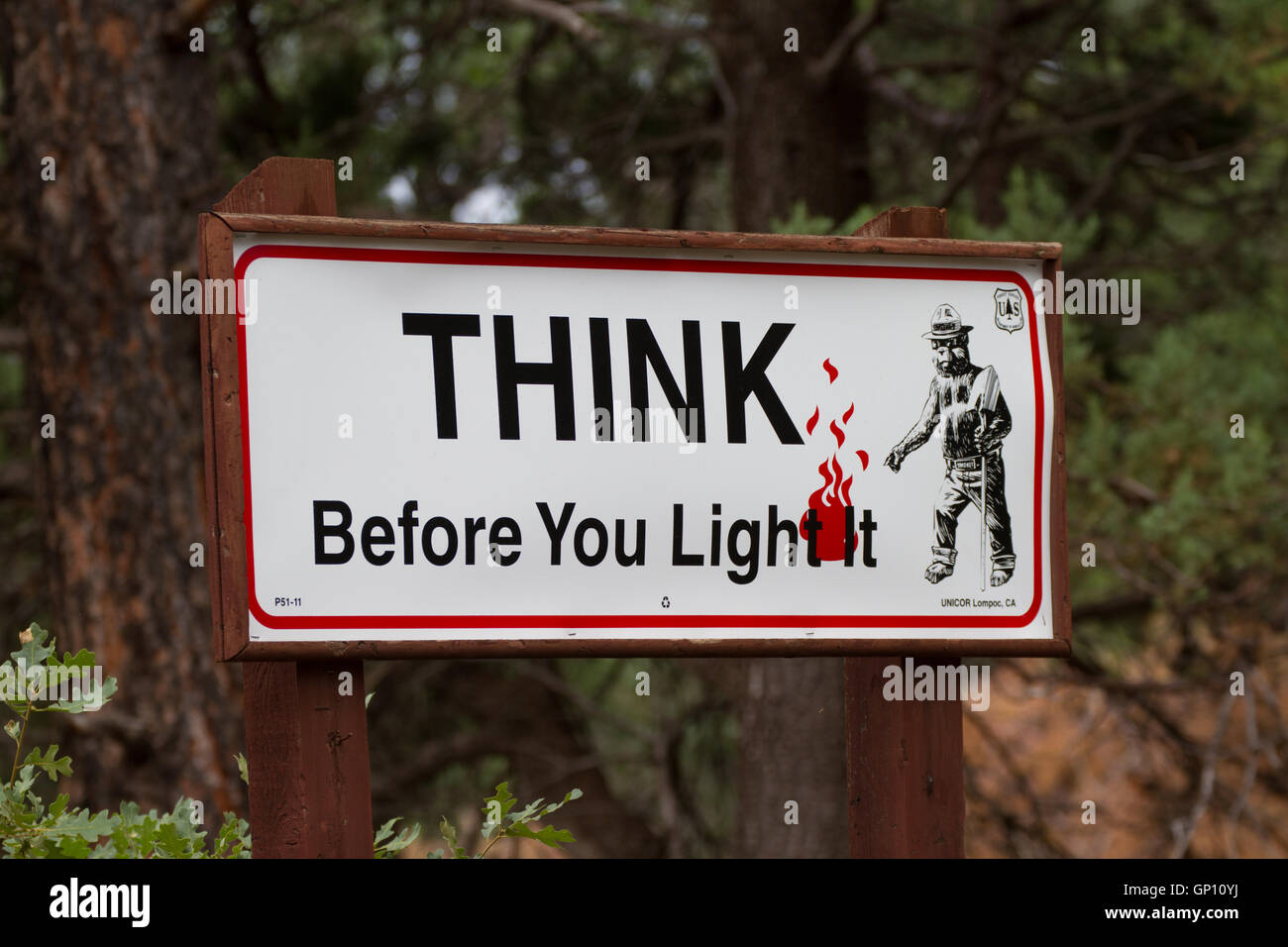 Think Before You Light fire safety sign. USA - Stock Image