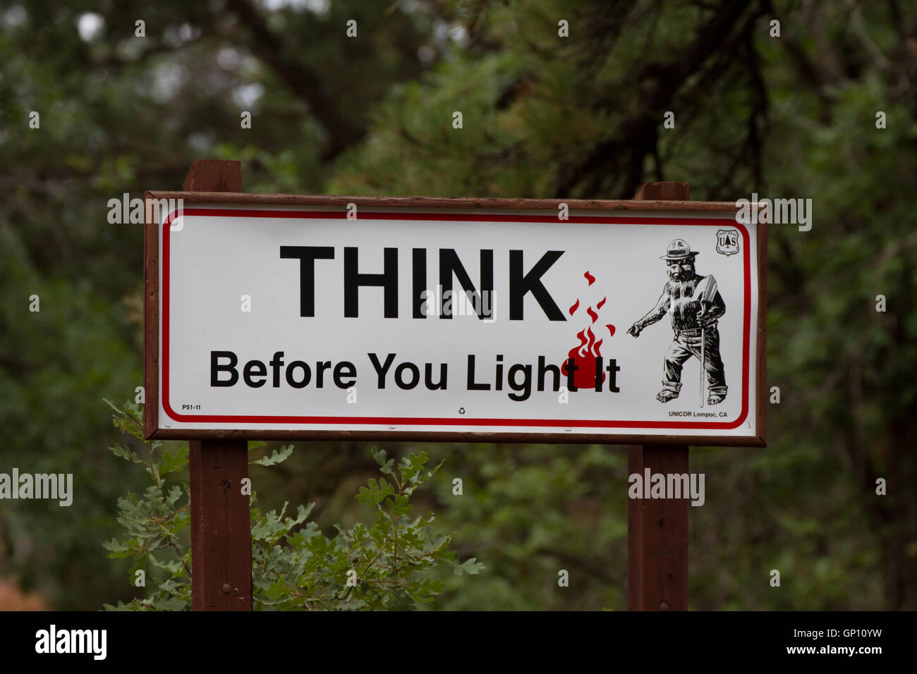 Think Before You Light fire safety sign USA - Stock Image