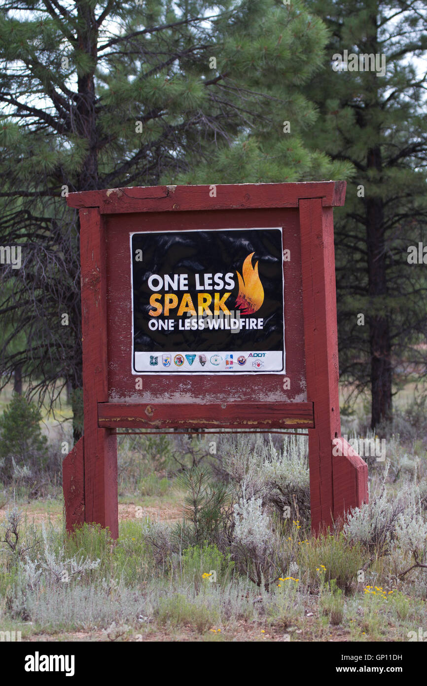 One Less Spark fire safety sign USA - Stock Image