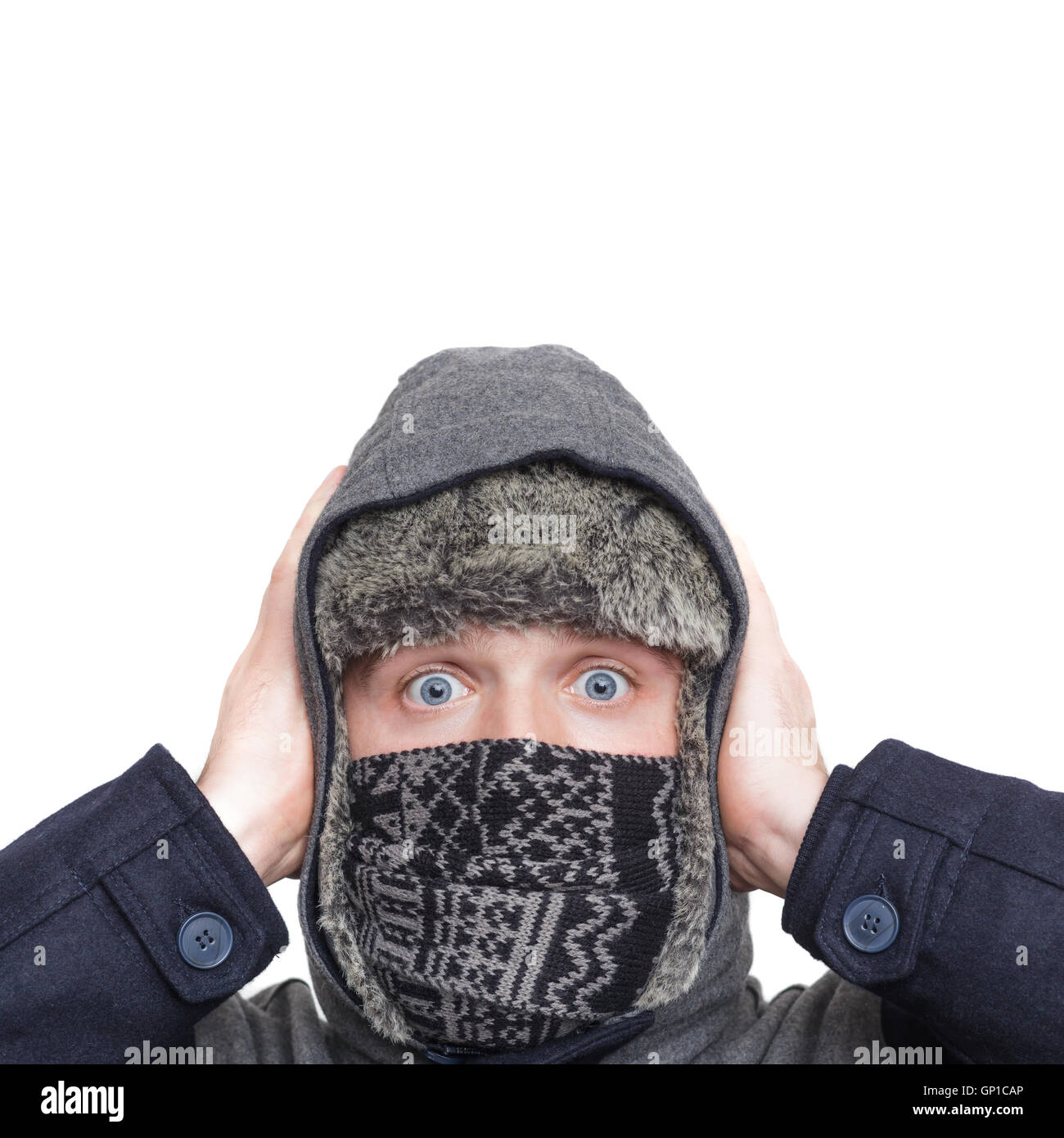c7a7fb20a71 Young man in hat and scarf very surprised. Hands pressed to the head. -