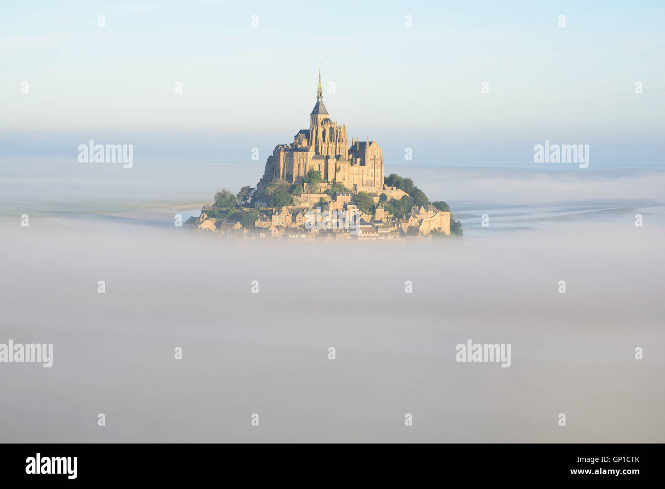 ABBEY ABOVE THE MORNING FOG (aerial view). Mont Saint-Michel, Manche, Normandy, France. Stock Photo