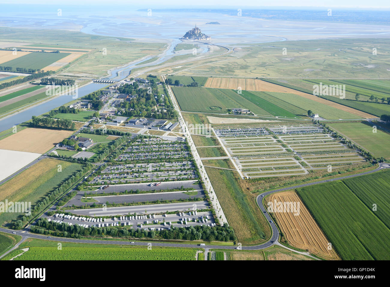 LARGE PARKING INFRASTRUCTURE FOR THE MONT SAINT-MICHEL'S VISITORS  (aerial view). Manche, Normandy, France. - Stock Image