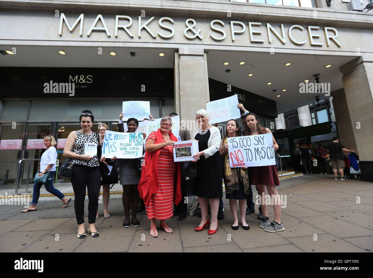 A group gathers outside Marks and Spencer's flagship store in Oxford Street, London, to hand in a petition calling - Stock Image
