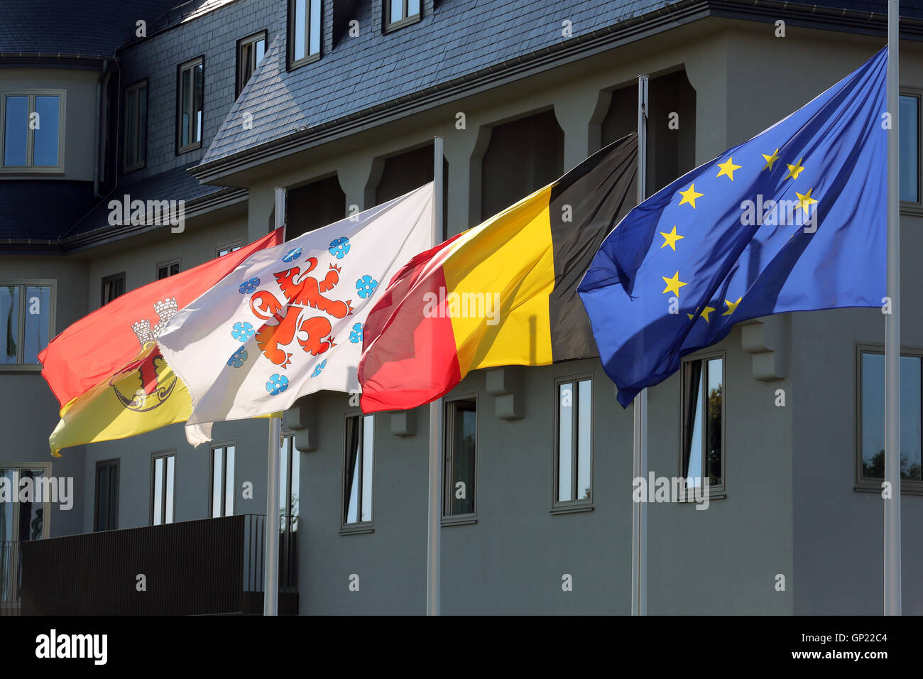 Parliament building of the German speaking Community in Eupen, Belgium. Flags from left to right: City of Eupen, Stock Photo