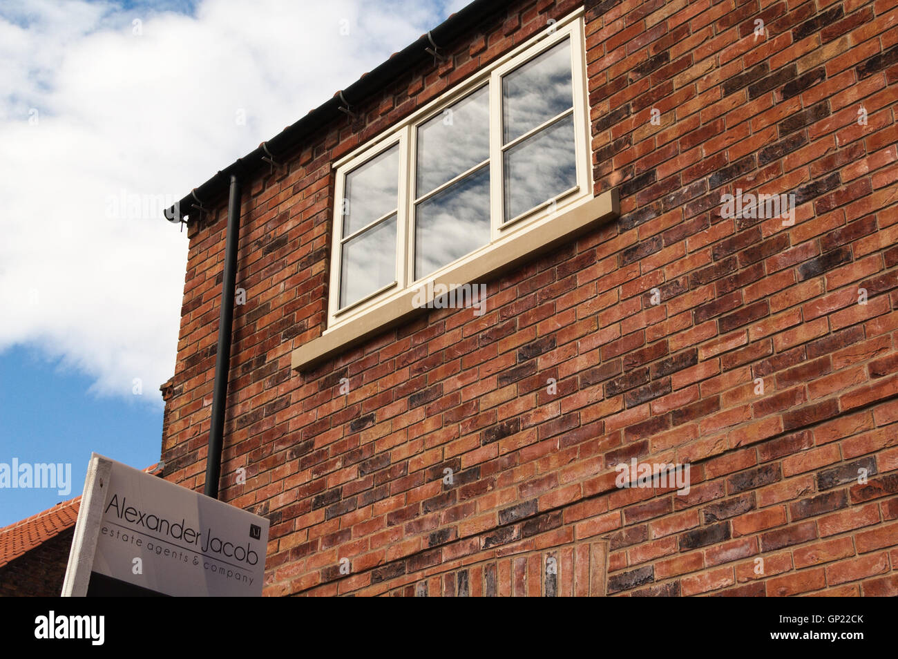 New build house using reclaimed brick House for sale - Stock Image