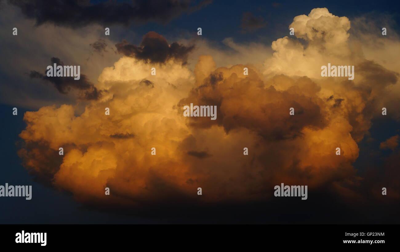 Cumulonimbus Clouds before Thunderstorm while Sunset - Stock Image