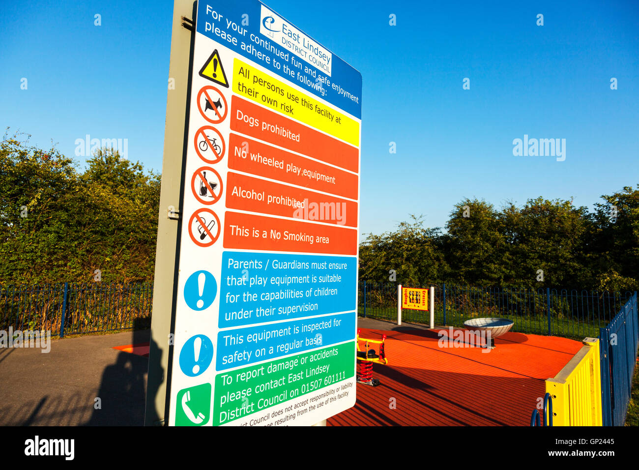 Park rules play parks warnings health and safety board sign signs restrictions UK England GB - Stock Image