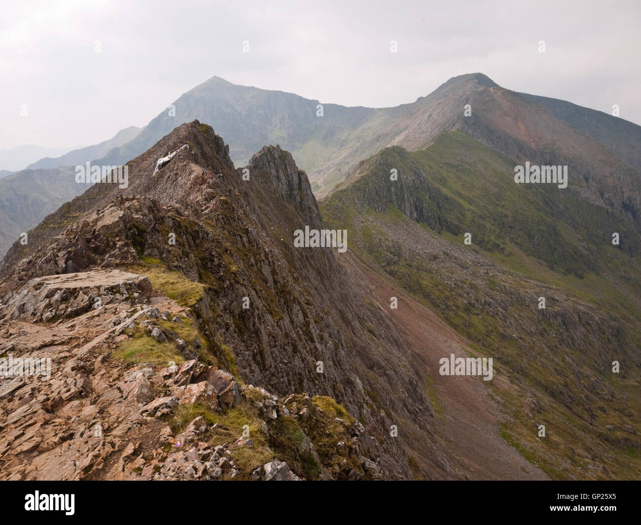 The Crib Goch arete leading to Carnedd Ugain and Yr Wyddfa on the Snowdon Horseshoe. - Stock Image