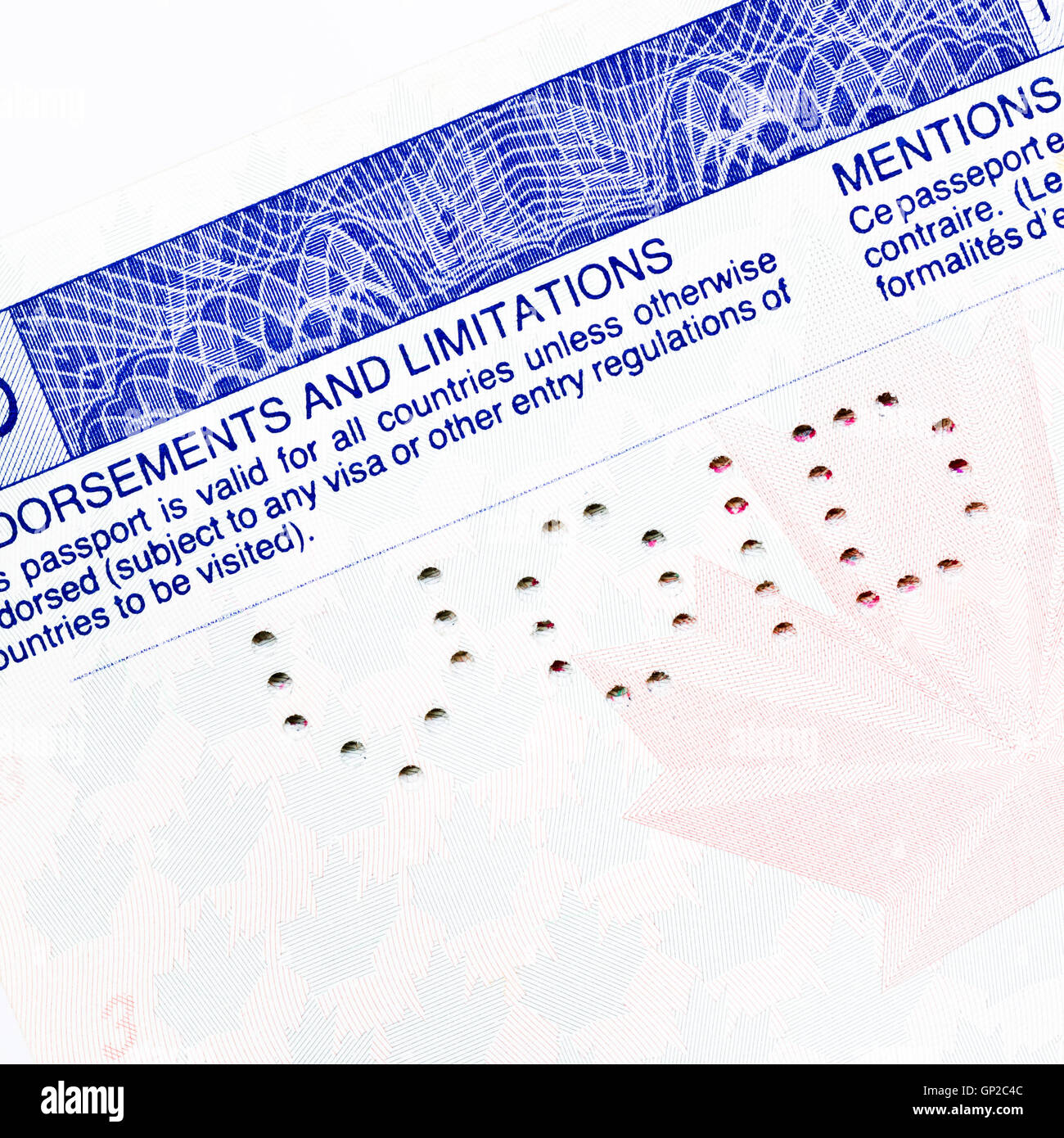 Canadian Passport page with punched out holes spelling void - Stock Image