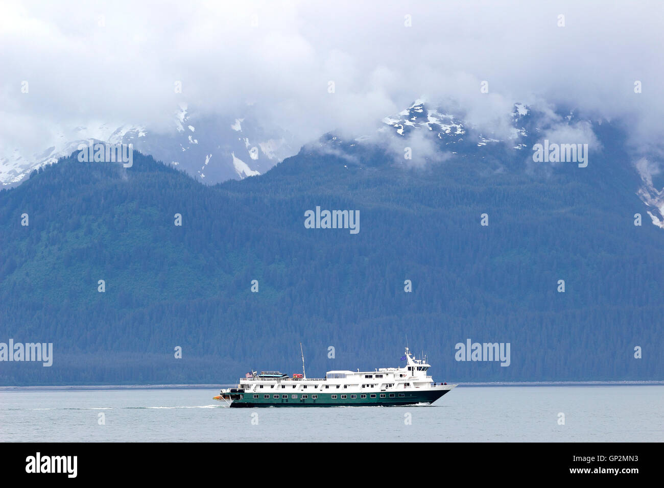 Cruise Ship Wilderness Discoverer Fog clouds Galcier Bay Inside Passage Southeast Alaska USA - Stock Image