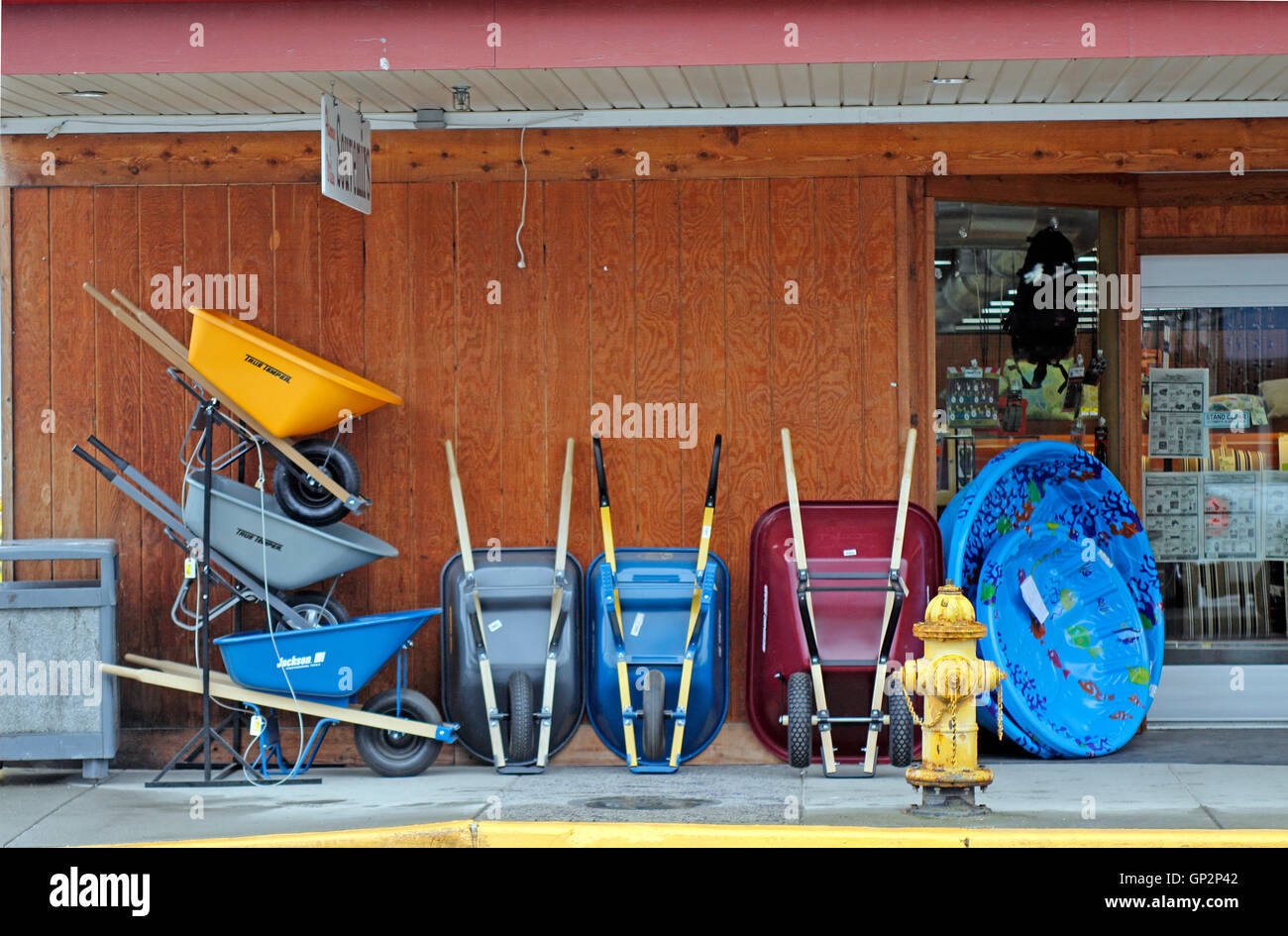Hardware store display wheelbarrows Petersburg 'Little Norway' fishing village Mitkof Island Inside Passage - Stock Image