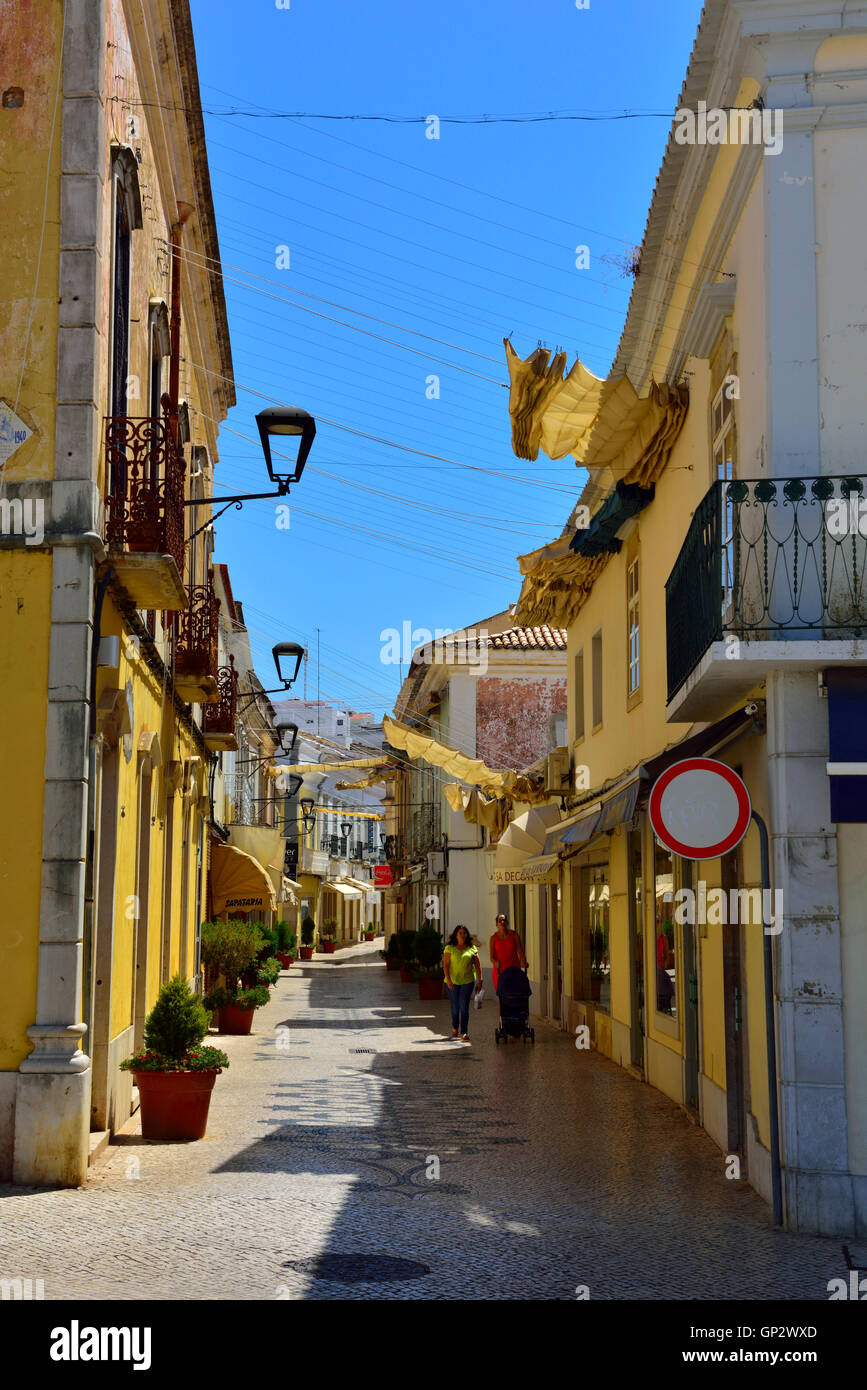 A quiet Sunday in narrow shopping street of inland town of Loulé, Algarve, south Portugal. - Stock Image