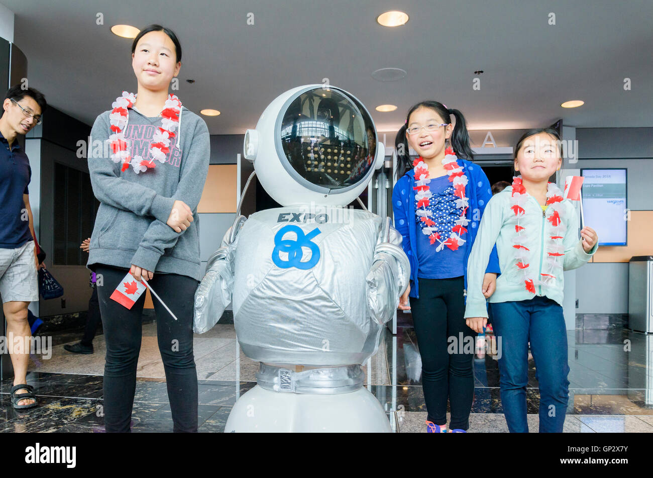 Kids celebrate Canada Day with Expo Ernie robot  downtown Vancouver, British Columbia, Canada, - Stock Image
