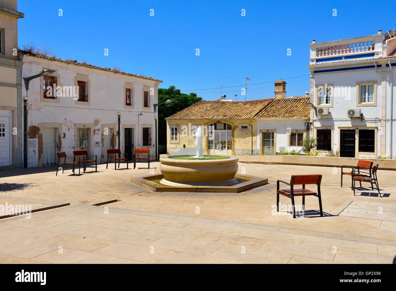 Square with seating on a quiet Sunday near the castle in the inland Algarve town of Loulé, south Portugal. - Stock Image