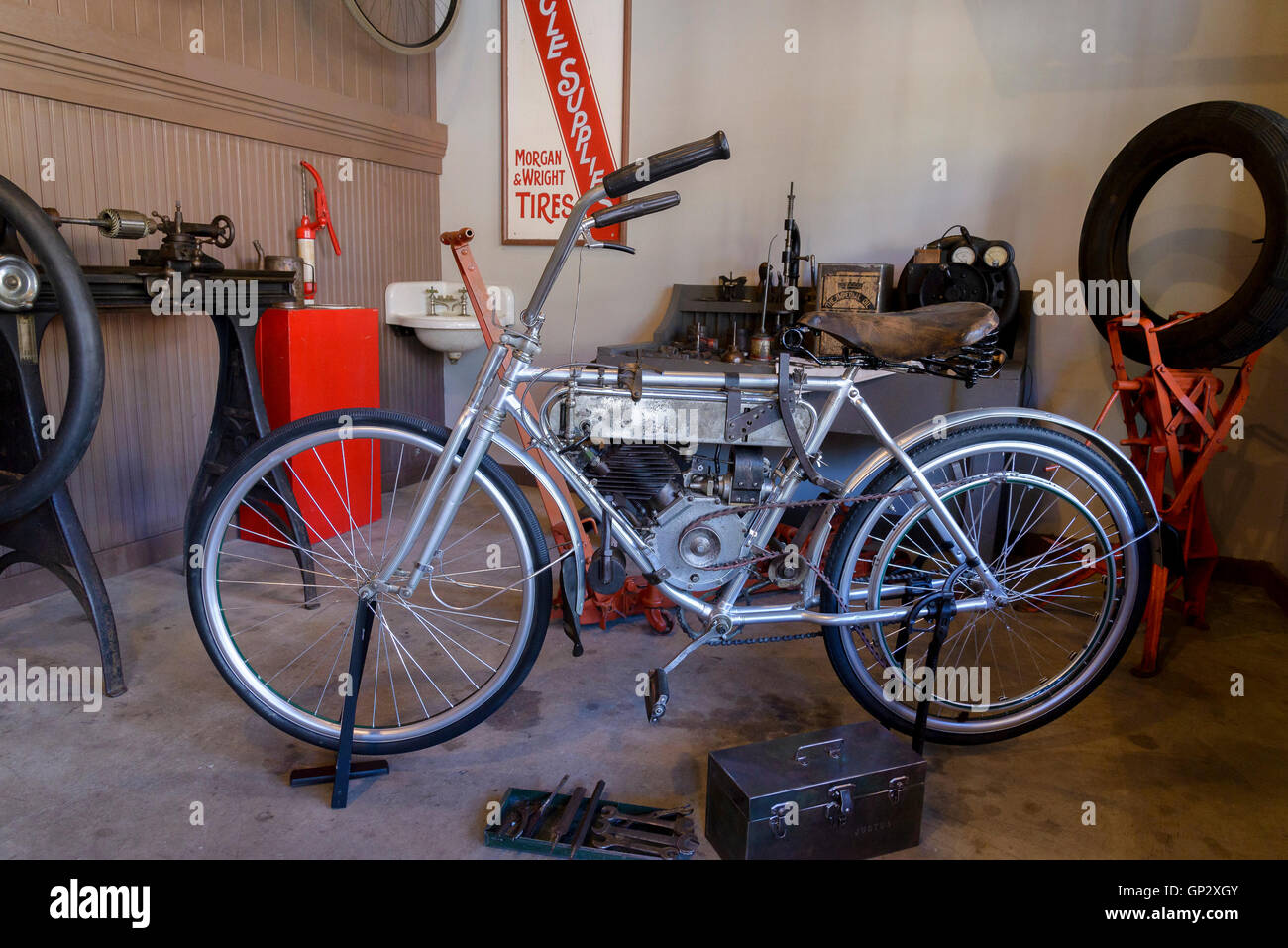 Antique gas powered bicycle, Burnaby Village Museum, Burnaby, British Columbia, Canada - Stock Image