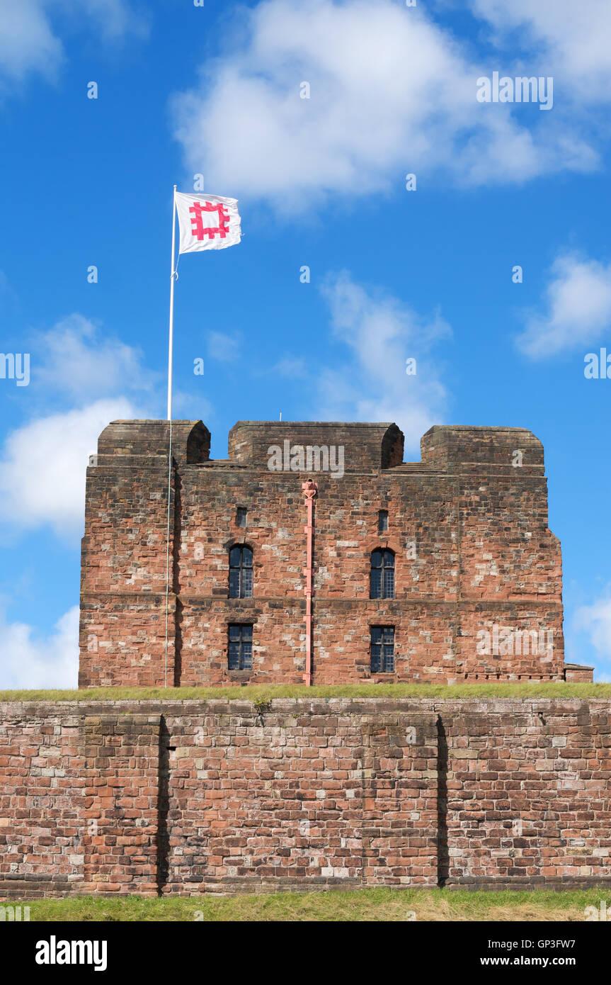 Carlisle castle keep with English Heritage flag flying, Cumbria, England, UK Stock Photo
