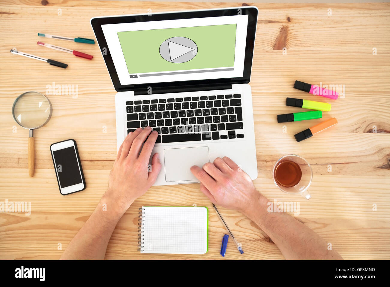 video play button on the screen of laptop computer, audio streaming online, multimedia website - Stock Image
