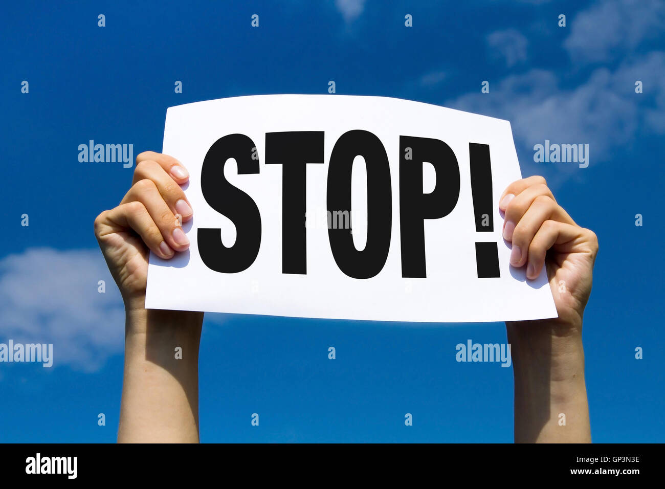 stop, hands holding paper sign, concept - Stock Image