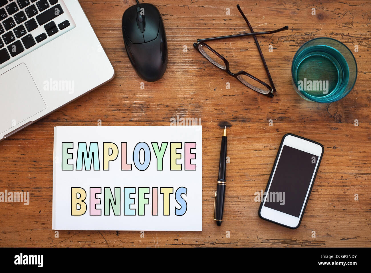 employee benefits concept, note in the notepad on wooden table - Stock Image