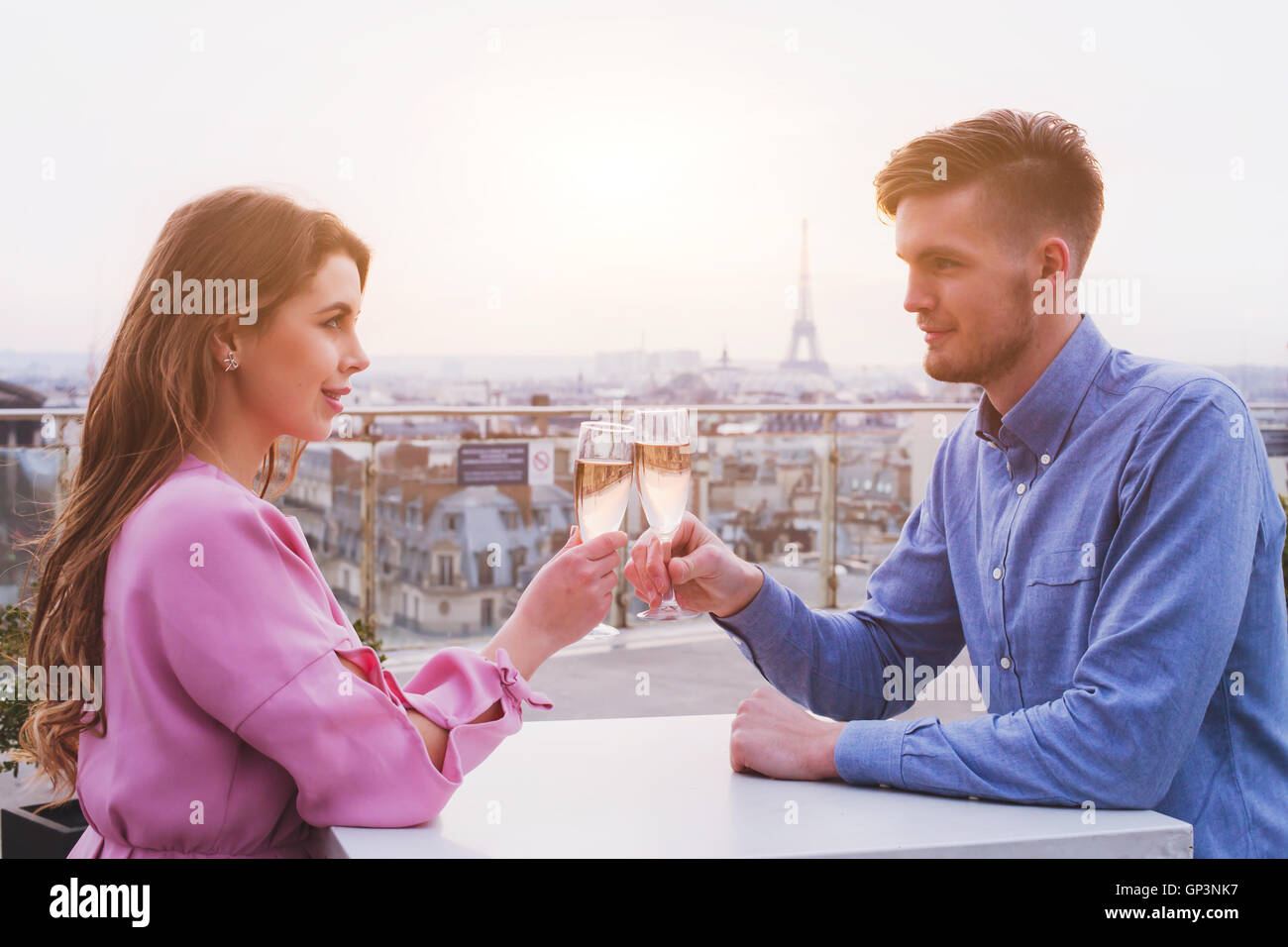 romantic dinner for couple in luxurious restaurant in Paris with panoramic city view and Eiffel tower - Stock Image
