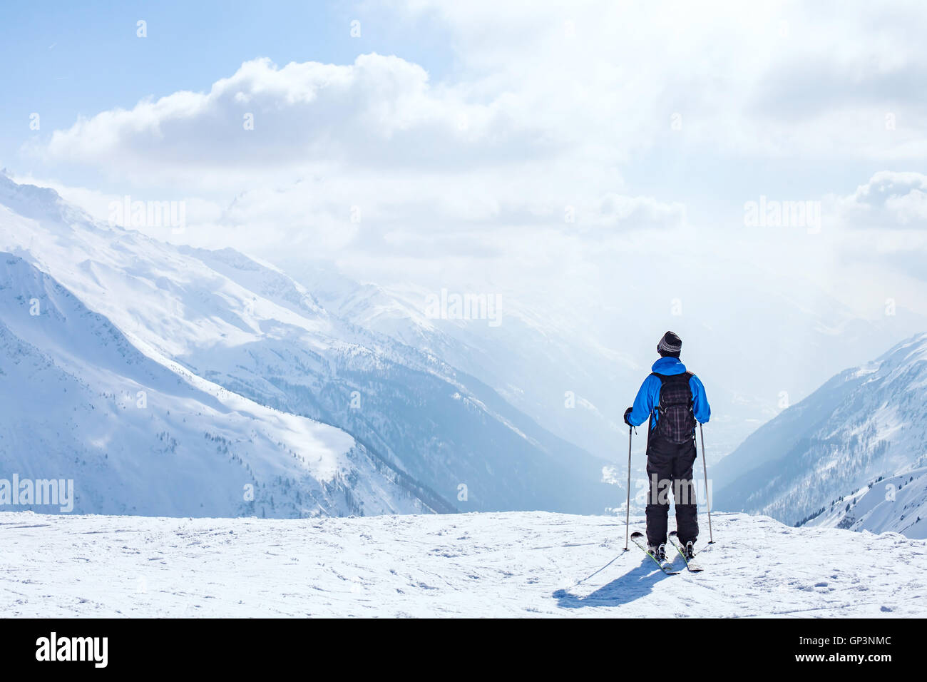 skiing background, skier in beautiful mountain landscape, winter holidays in Alps - Stock Image