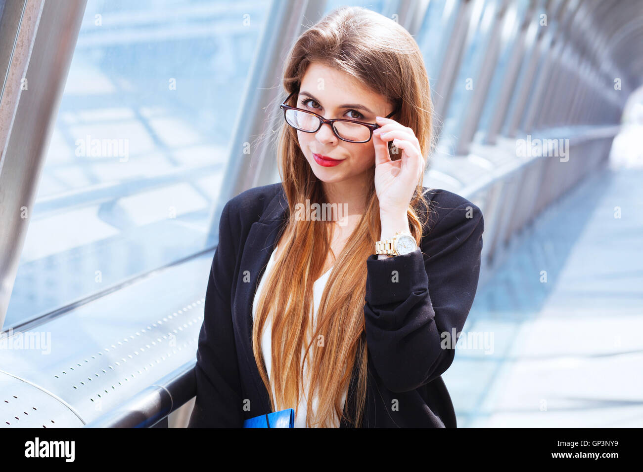 suspicious tricky strict business woman, real estate agent - Stock Image