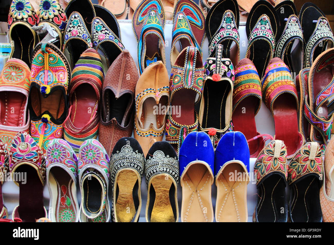 Hand crafted, colorful shoes on display at Jaisalmer Fort, Jaisalmer, Rajasthan, India, Asia - Stock Image