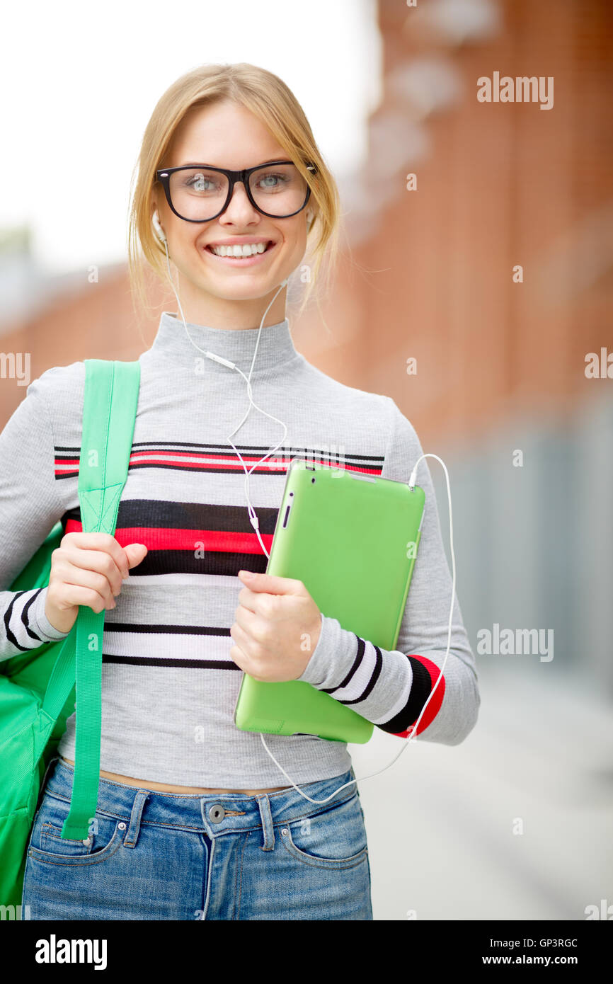 girl holding her tablet in campus park Stock Photo