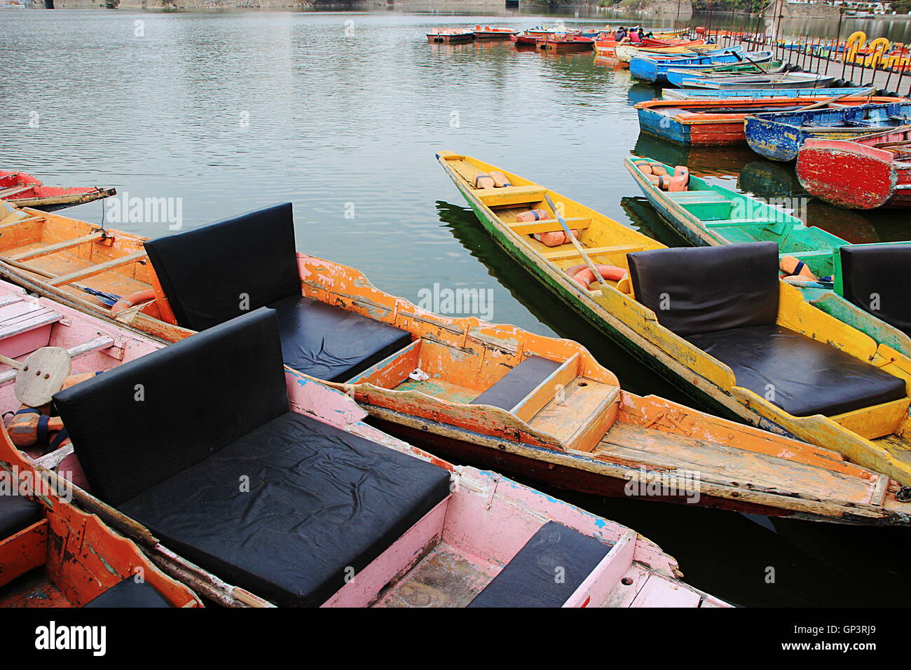 Attractive, colorful row boats waiting for tourists at Nakki Lke, Mount Abu, Rajasthan, India, Asia - Stock Image