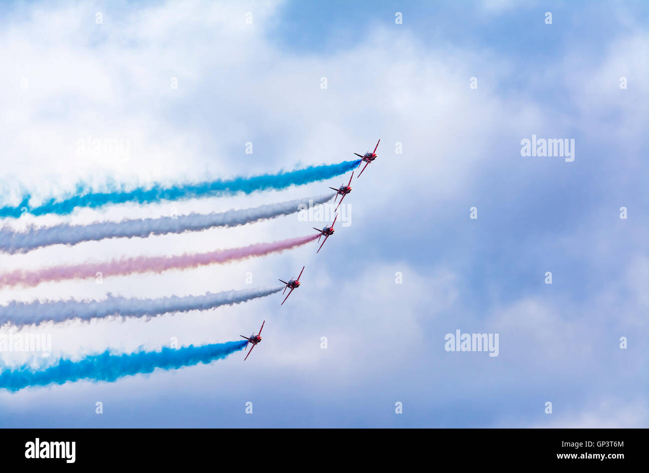 Royal Air Force Aerobatic Team (Red Arrows) flying display over Falmouth Harbour in Cornwall in August 2016. - Stock Image