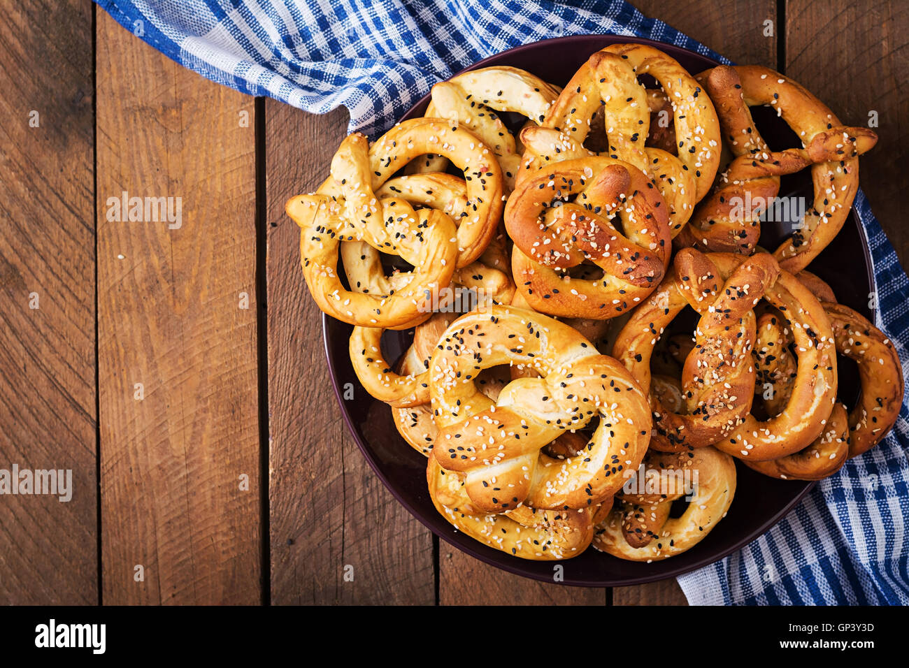 oktoberfest salted soft pretzels in a plate from germany on wooden