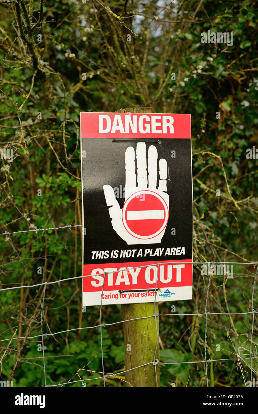 Notice warning children to keep away from a quarry. - Stock Image