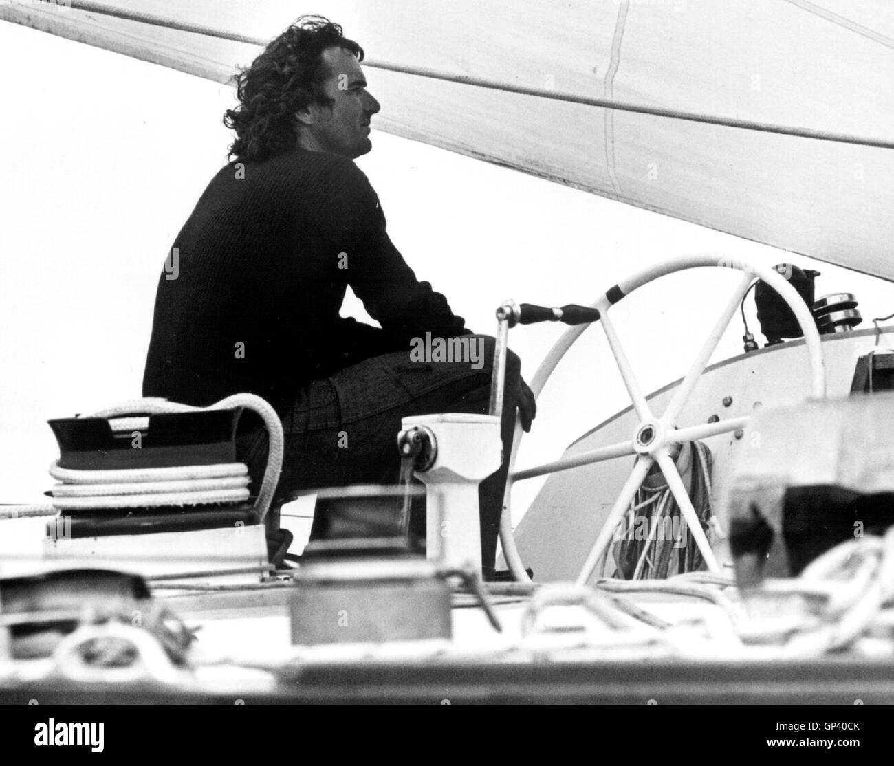 AJAX NEWS PHOTOS. 1976. PLYMOUTH, ENGLAND.  - OSTAR RACE - JEAN YVES TERLAIN (FR) AT THE WHEEL OF THE HUGE ITT OCEANIC - Stock Image