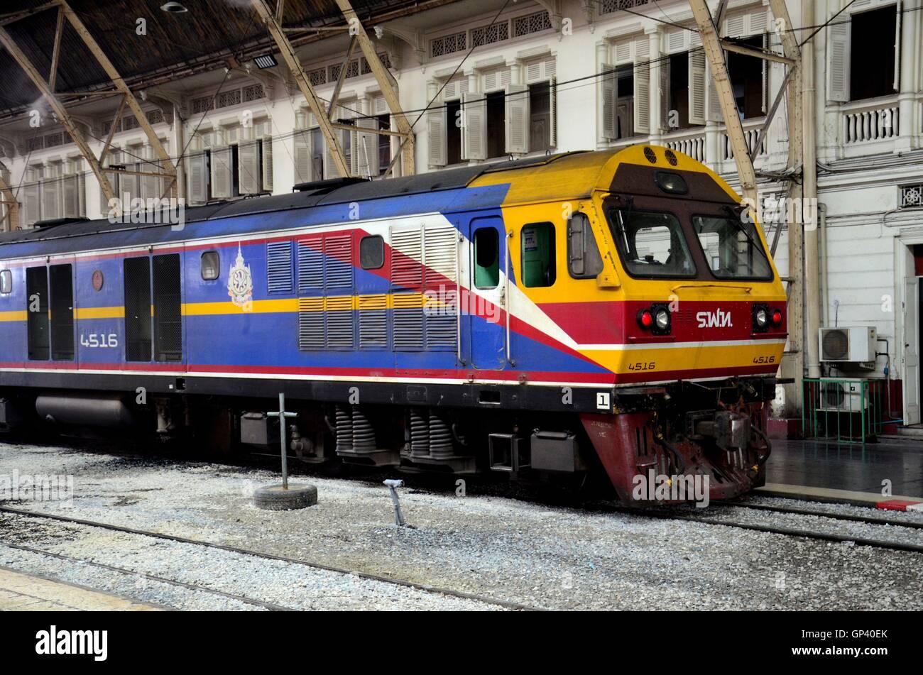 Blue and yellow Thai railways diesel electric locomotive parked at Hua Lamphong Bangkok train station Thailand Stock Photo