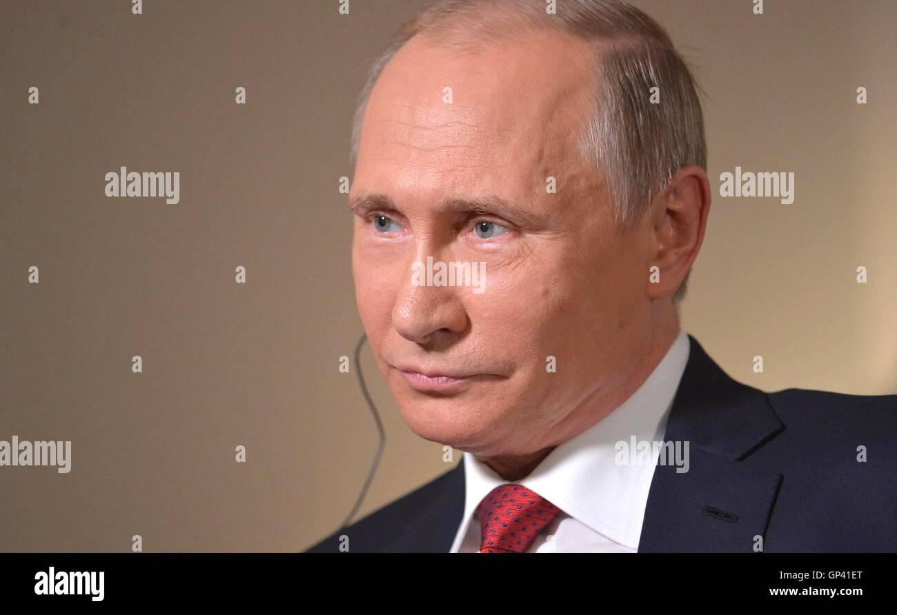 Russian President Vladimir Putin listens to a question during an interview with Bloomberg News September 1, 2016 - Stock Image