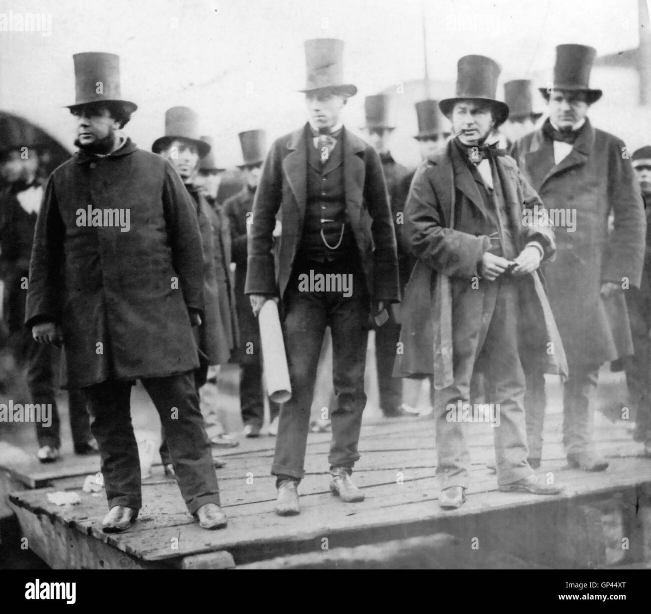 ISAMBARD KINGDOM BRUNEL (1806-1859) English engineer at the launch of the Great Eastern in January 1858. From left: - Stock Image