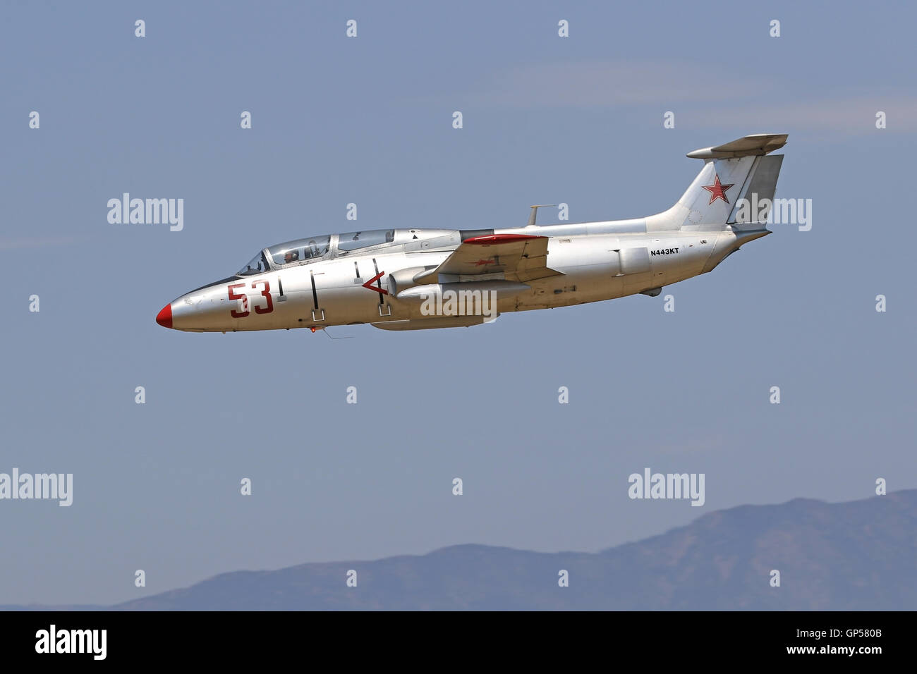 Jet airplane L-29 Delphin military trainer of the Soviet Union flying at air show - Stock Image