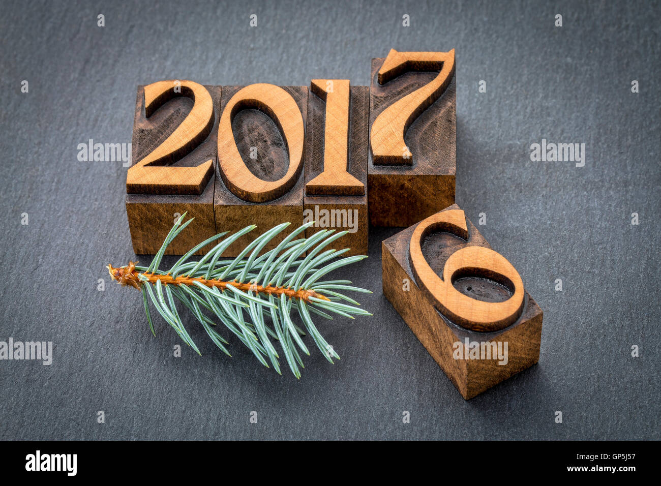 new year 2017 replacing the old year 2016 - letterpress wood type printing blocks on a slate stone - Stock Image