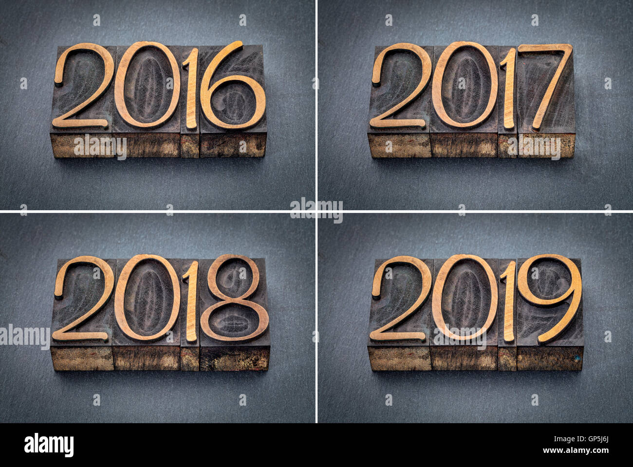 year 2016, 2017, 2018 and 2019 set - text in letterpress wood type against gray slate stone - Stock Image