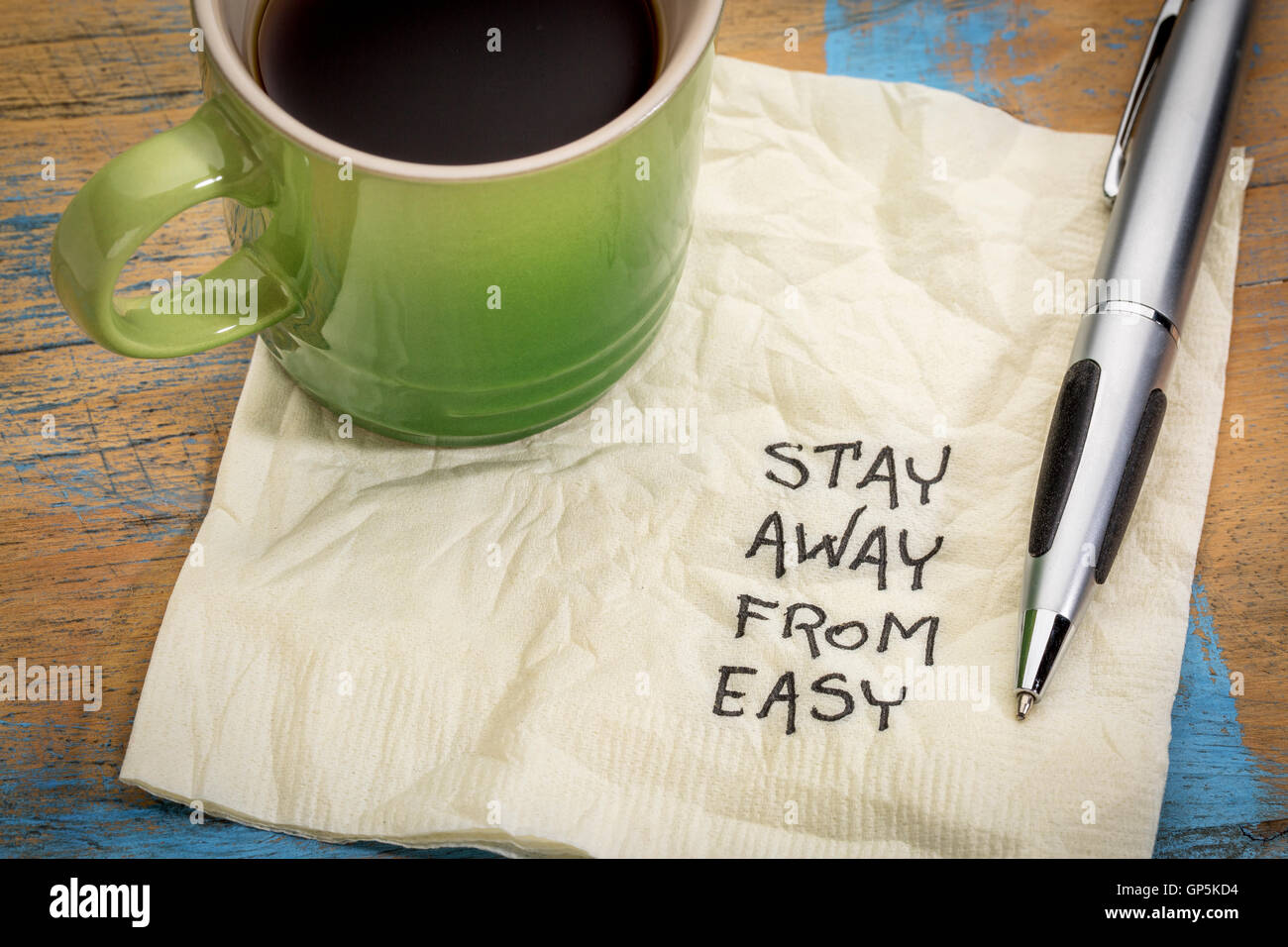 Stay away from easy advice or reminder - handwriting on a napkin with a cup of coffee - Stock Image