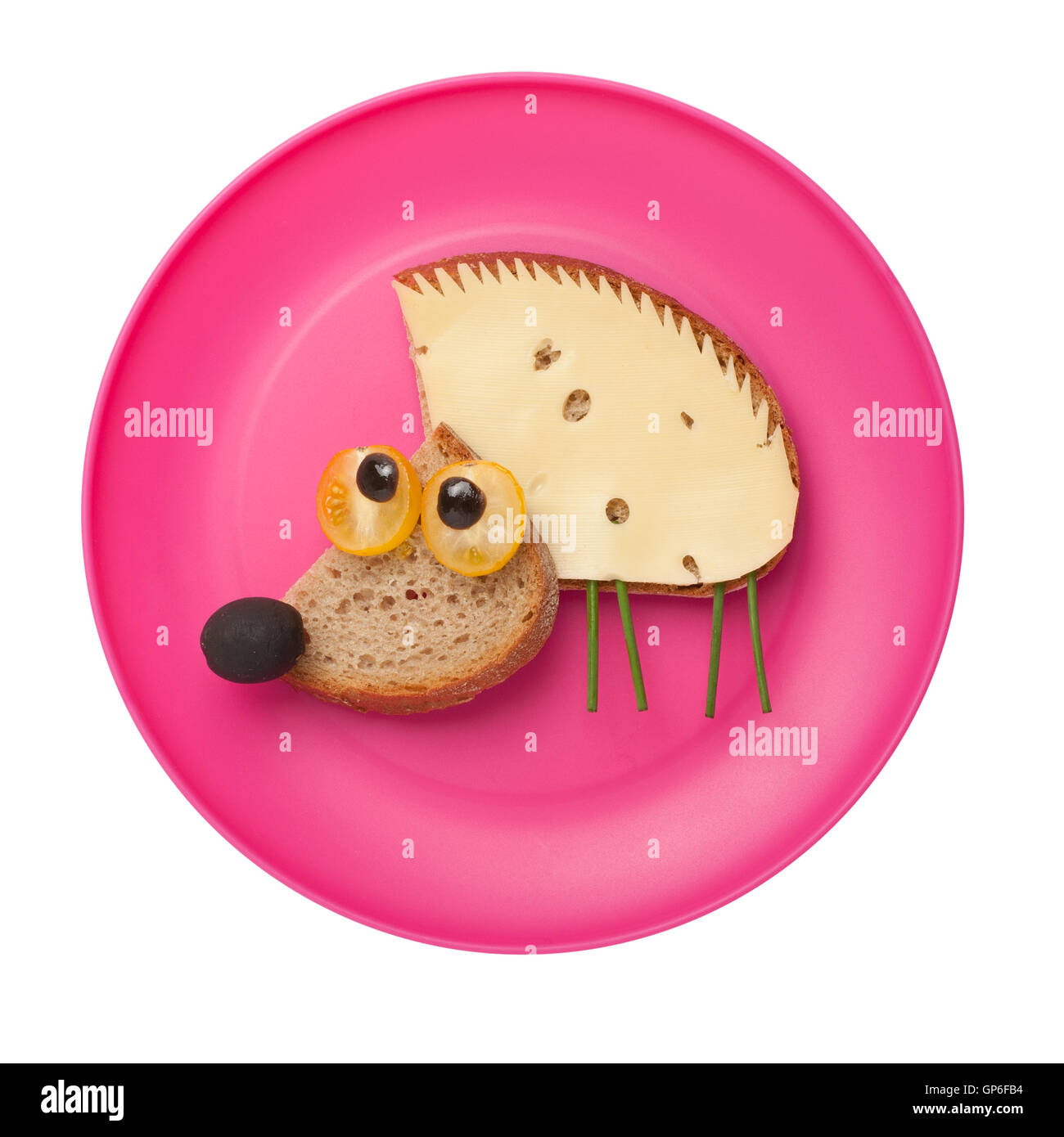 Amusing hedgehog made of bread and cheese on plate - Stock Image