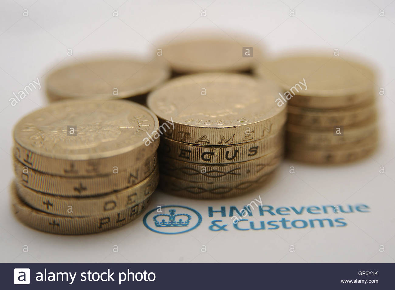 File photo dated 27/01/15 of pound coins next to the HM Revenue & Customs logo. Corporation tax should be scrapped Stock Photo